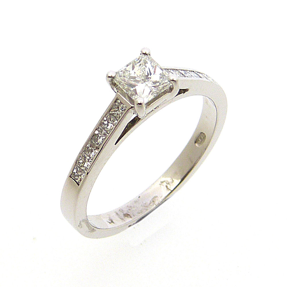Solitaire Diamond Engagement Ring with Diamond Set Shoulders in 18ct. White Gold
