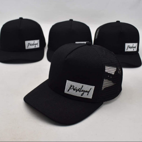 Privileged trucker hat