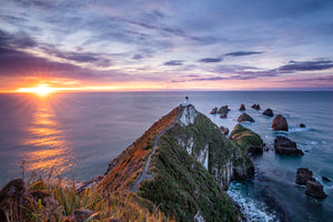 Sunstar on the horizon, Nugget Point Lighthouse