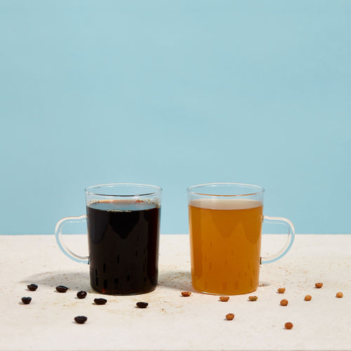 Photo of two clear mugs against a blue background; one contains Golden Ratio gold coffee, the other a regular dark roast.