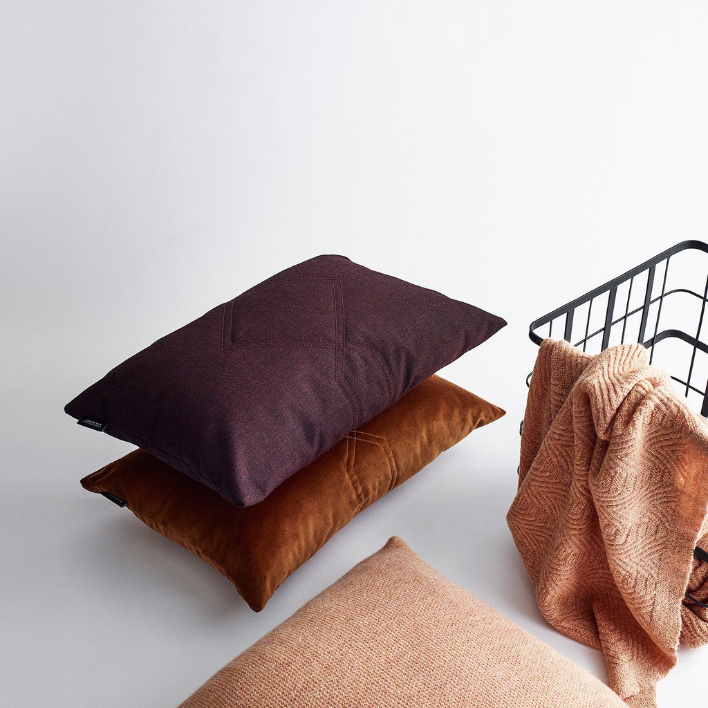 Stacked cotton velvet cushion in remix bordeaux and rusty.