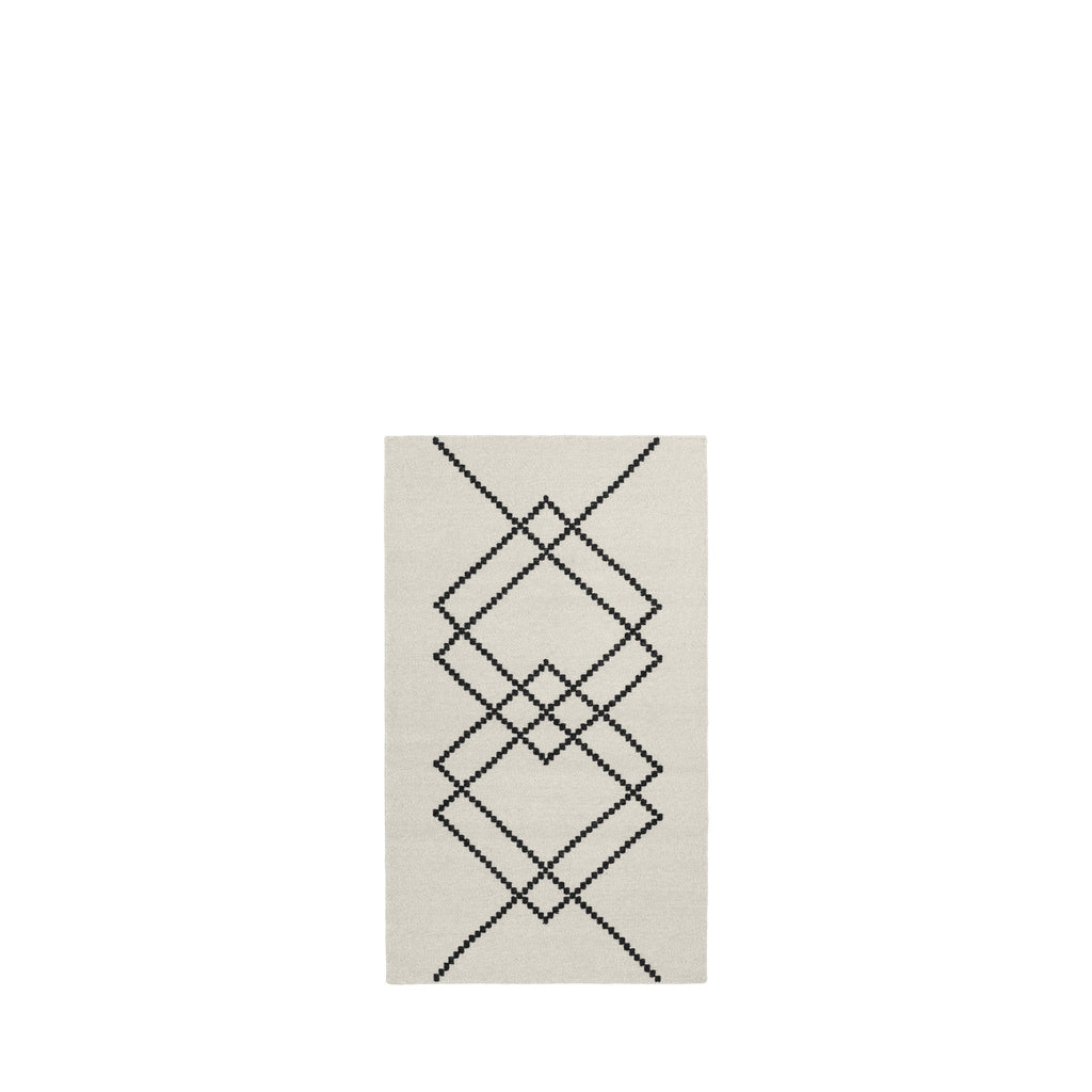 Packshot of BORG handwoven wool rug in the color Ecru with black graphic lines.