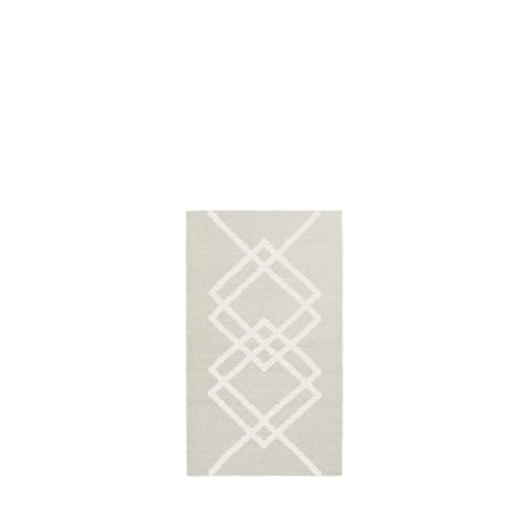 Packshot of BORG handwoven wool rug in the color ecru with ecru graphic lines.