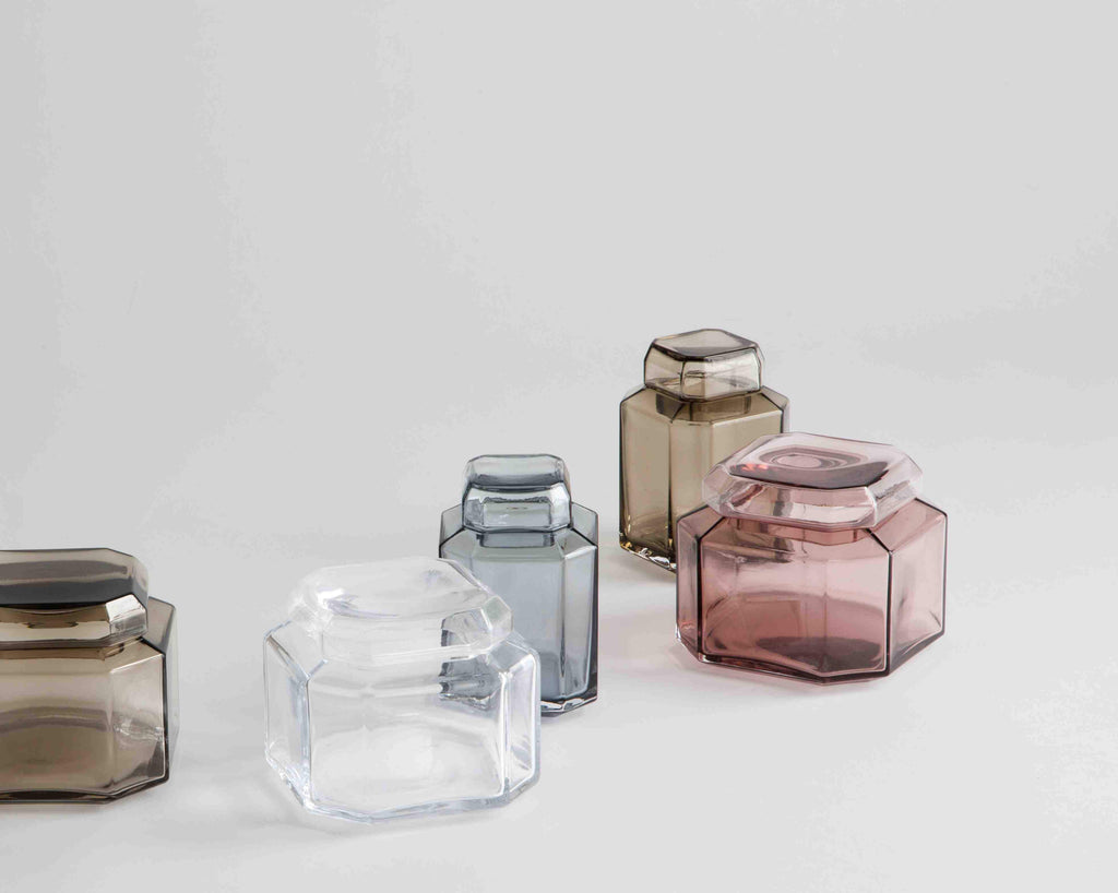 Mouth blown glass containers in different colors like blue, smoke, burgundy and clear