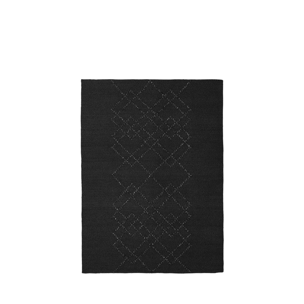 Packshot of black handwoven BORG wool rug with black graphic lines.