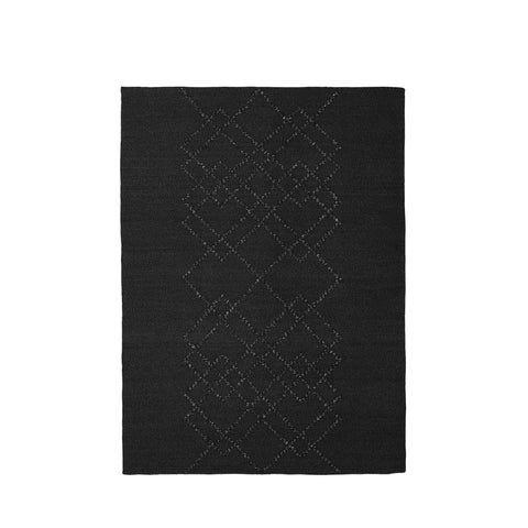 Packshot of black handwoven BORG wool rug with graphic black lines.