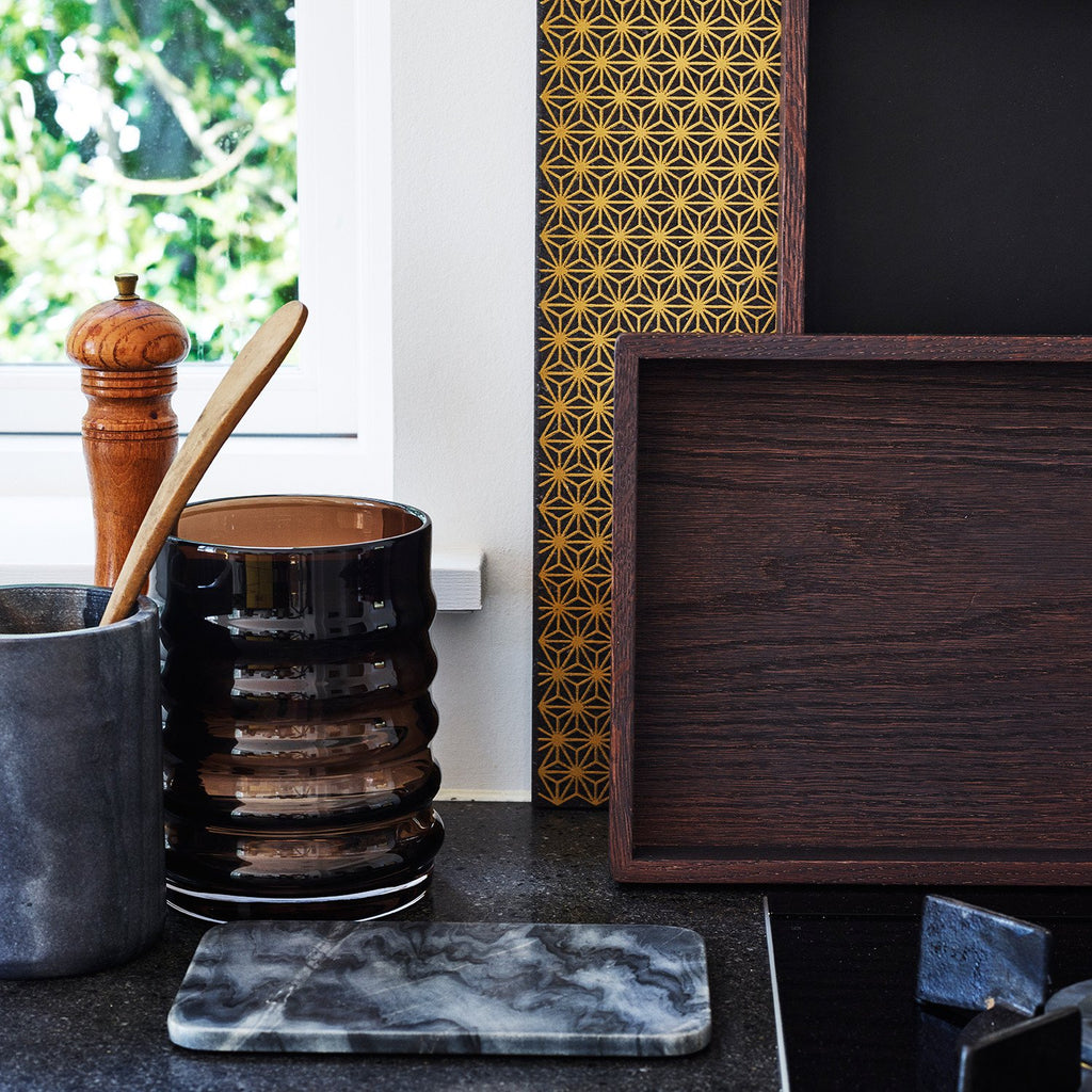 Black marble plate and vase in inspirational kitchen settings.