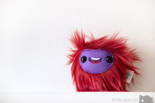 Smoosh The Sprite Squeaking Round Plush Monster Companion Plush