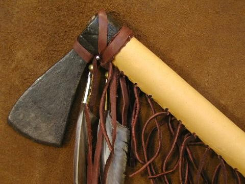 The buckskin leather is hand stitched and trimmed with genuine feathers