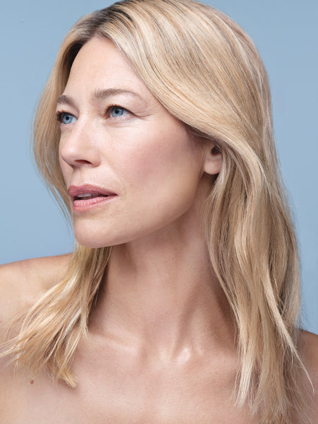 A woman with the hydrating and brightening skin