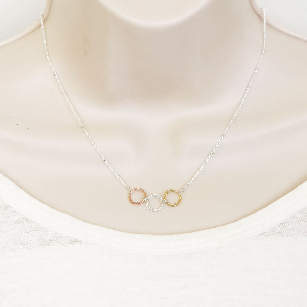 "The Triple Harmony necklace represents the harmony of our mind, body and spirit. Two 1"" hoops for each"