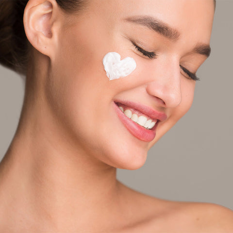 woman with cream heart on face