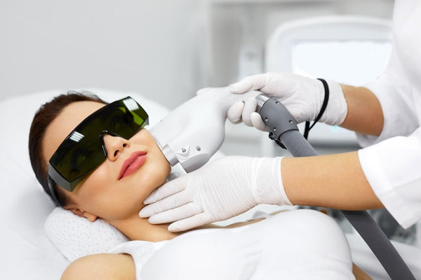Trainer using the Laser/ IPL In-Clinic, while conducting training
