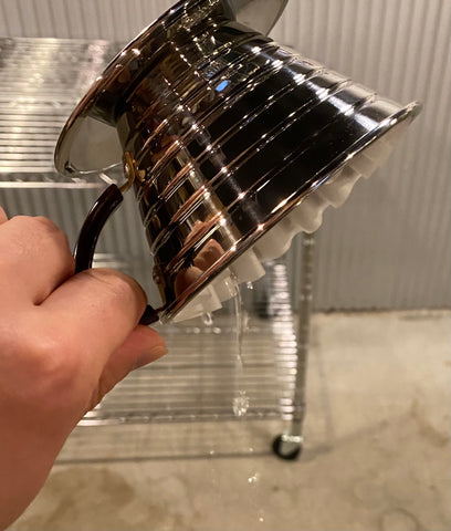 Flip your brewer to drain the rinsing water