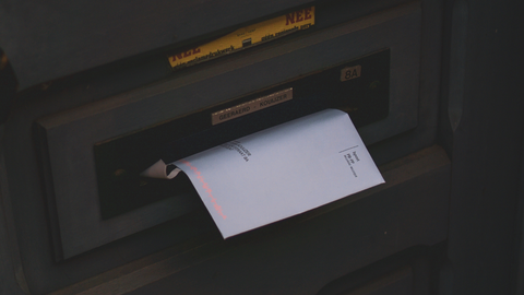 Mail in mailbox during summer vacation
