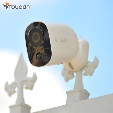 outdoor camera on a metal gate.