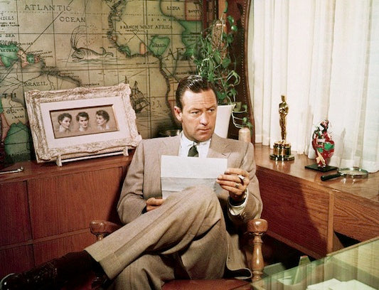 Oscar-winner William Holden relaxes in his home