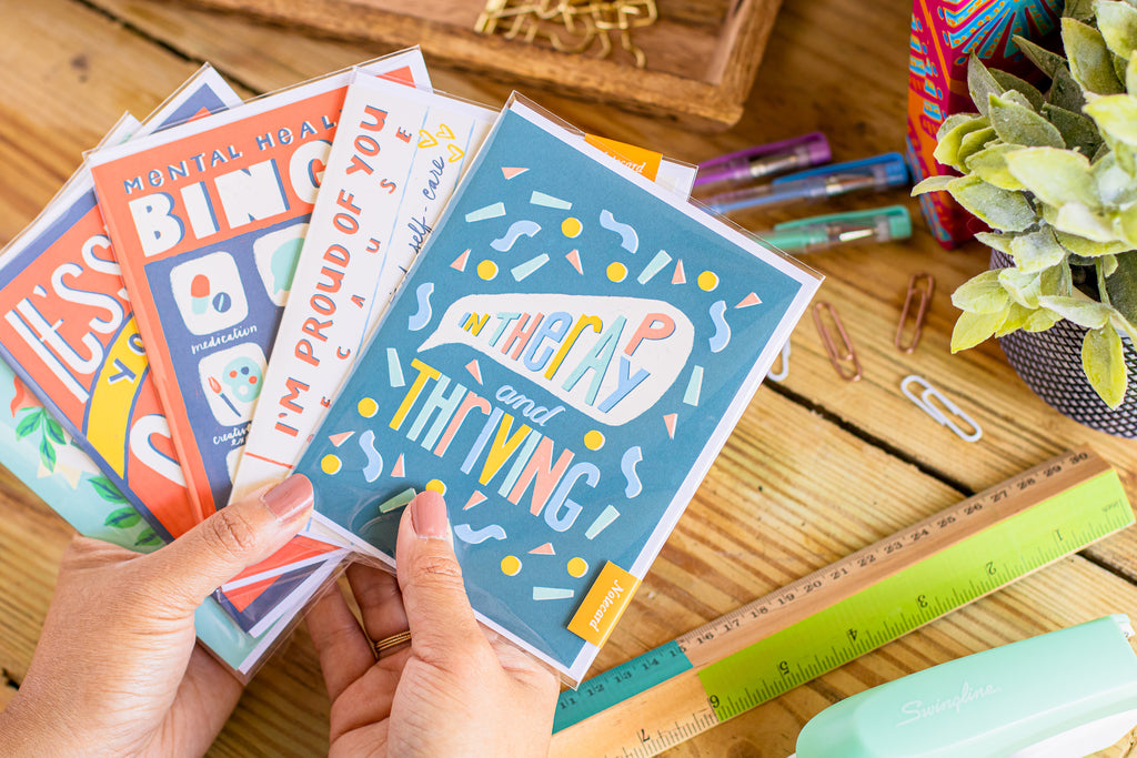 Mental health greeting cards by Curated Dry Goods pictured on a wooden desk