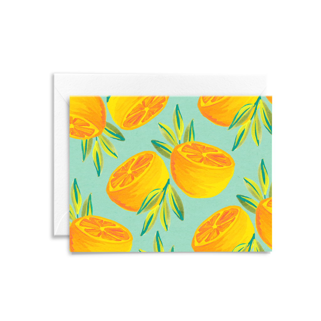 Hand painted orange pattern on eco-friendly stationery, with an aqua colored background