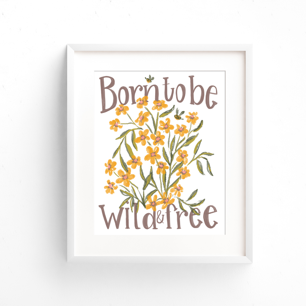 "Hand lettered quote ""Born to be wild and free"" is pictured here in this art print with yellow flowers, green leaves and two bumble bees"