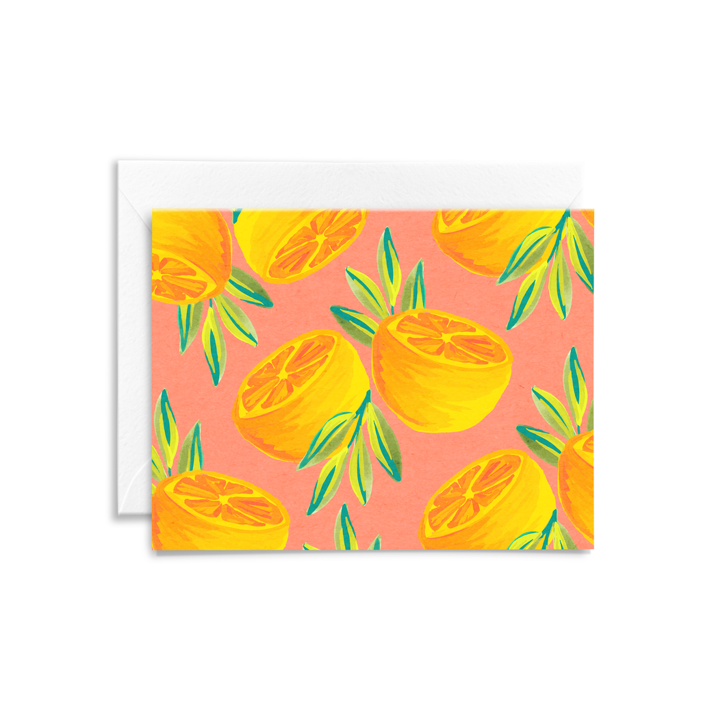 Folded notecard featuring hand painted oranges in gouache with a coral background printed on eco-friendly paper