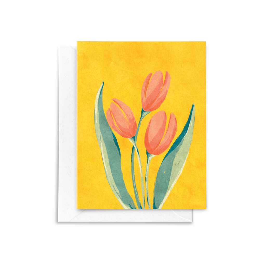 A folded notecard featuring a hand drawn French Tulip floral bouquet illustration with red, peach, and green details on a textured saffron yellow background.