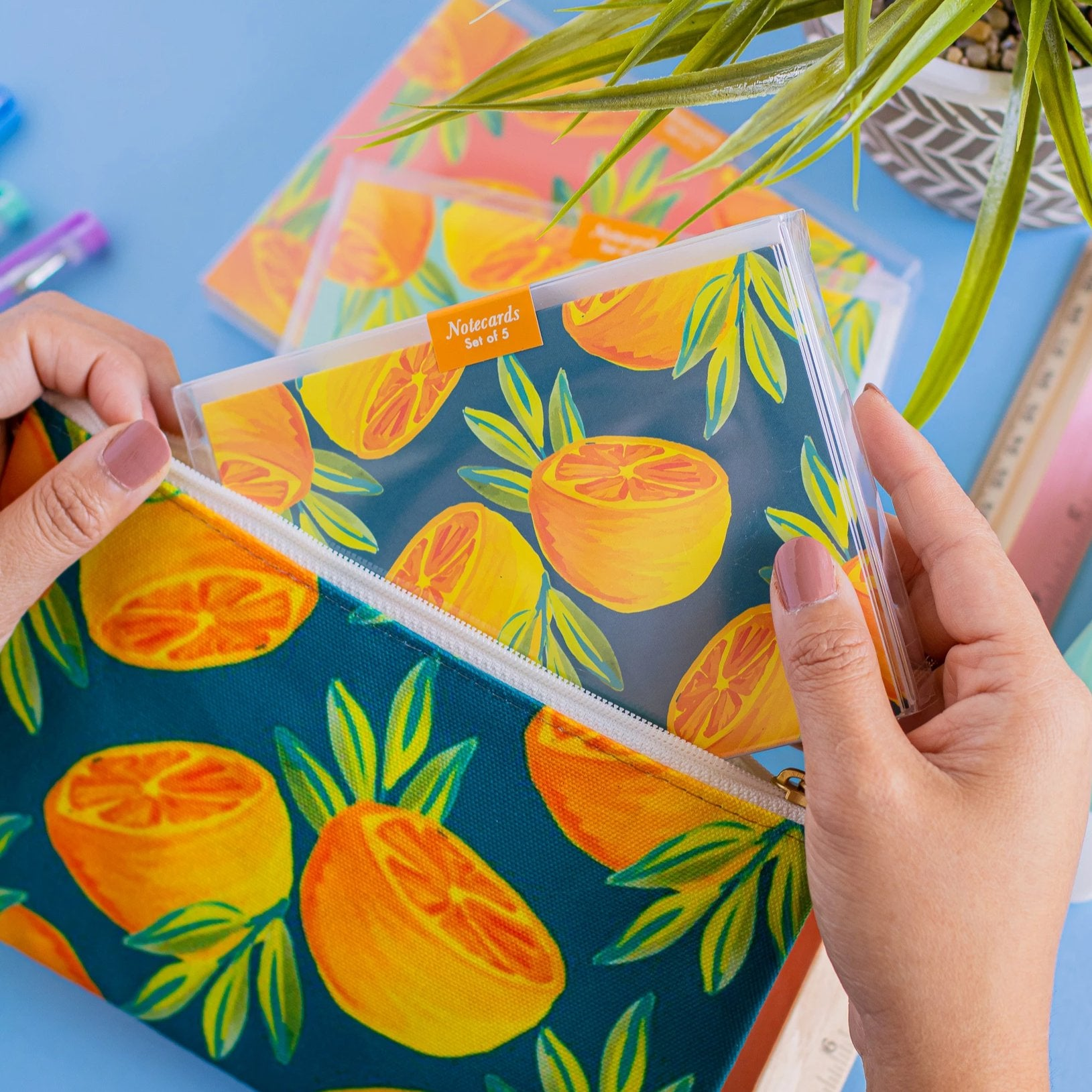 Hand painted orange print pencil case in forest