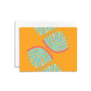 Turquoise monstera leaves painted on a tangerine orange background printed on eco-friendly stationery
