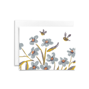 Eco-friendly folded notecard featuring floral illustration in blue, purple, and yellow