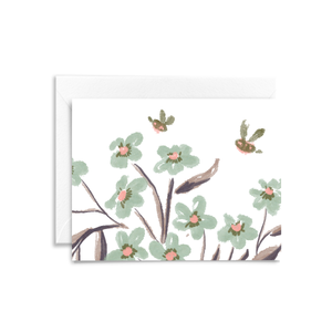 Seafoam green florals and purple leaves are hand illustrated with two bumble bees on this eco-friendly folded notecard