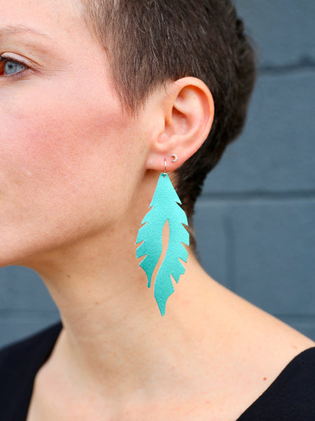 leather feather minis electric teal edge of urge original earrings
