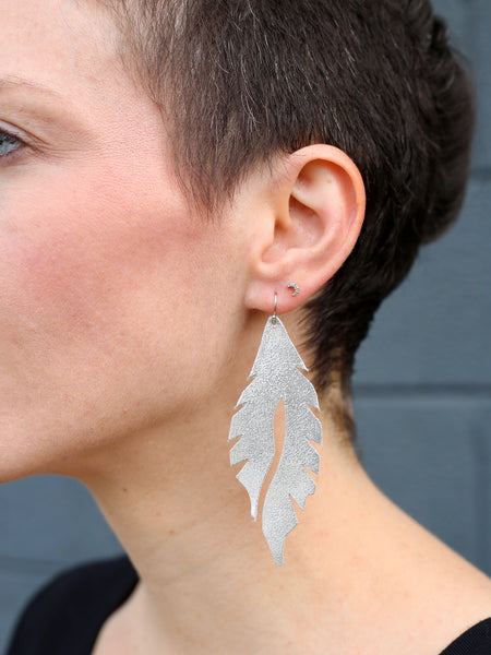 leather feather minis silver edge of urge original earrings