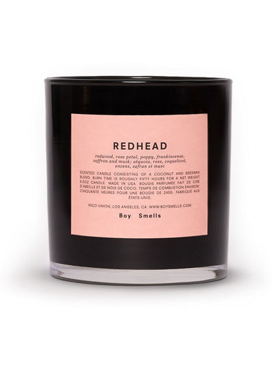 boy smells candles redhead