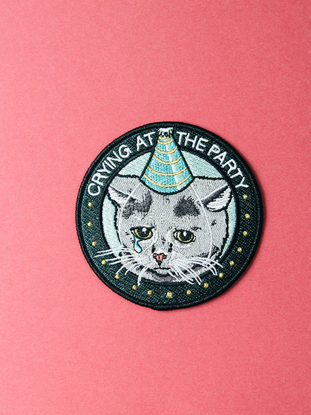 stay home club iron on patch crying at the party sad birthday cat