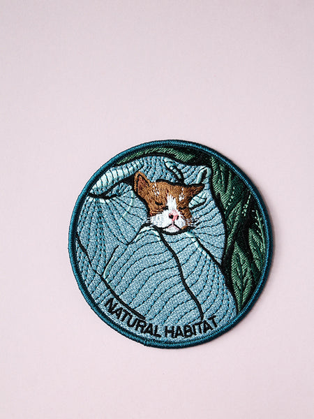 stay home club natural habitat iron on patch cat in bed