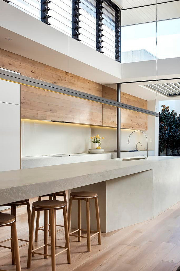 Crop Bar stools featured in this beautiful formed concrete kitchen.