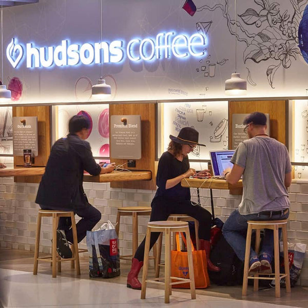 Solid Oak Crop Bar Stools designed by Relm Furniture featured in the new Hudsons Coffee store at Sydney International Airport