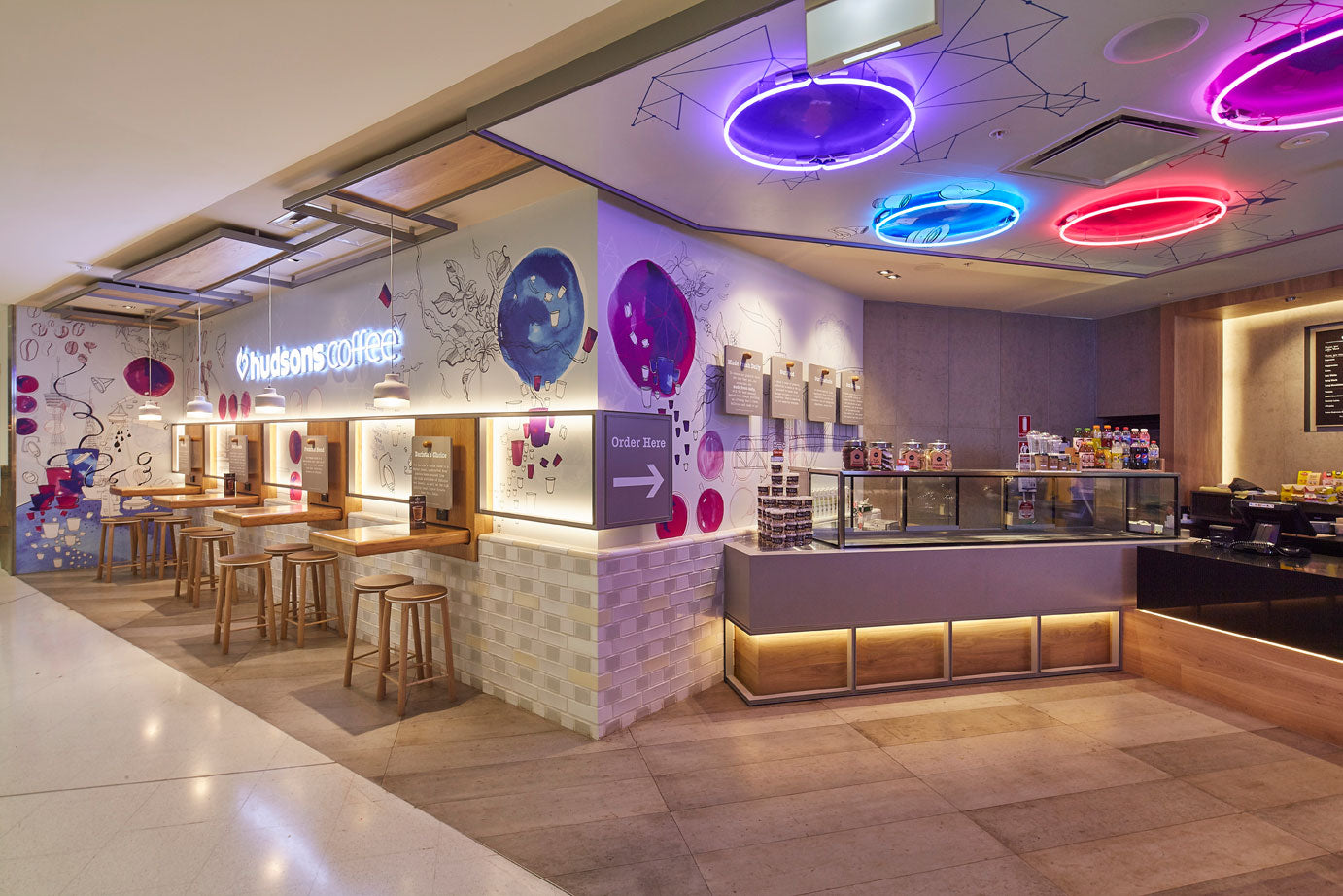 Relm furniture's Crop Bar stools featured in the retail fitout for Hudsons Coffee at Sydney international Airport.