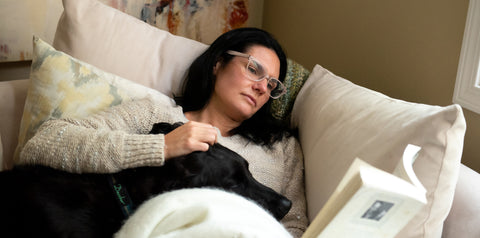Ami Wellness Founder Triniti reads with her dog