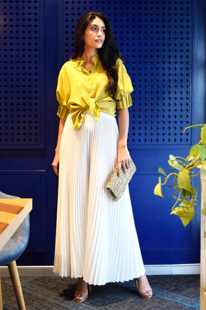 White pleated flared pants
