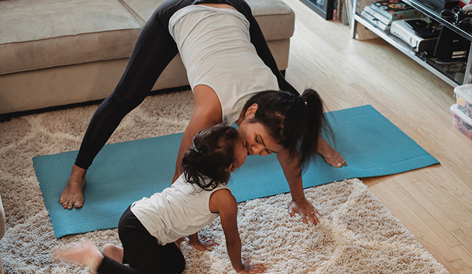 Mom and daughter stretching together