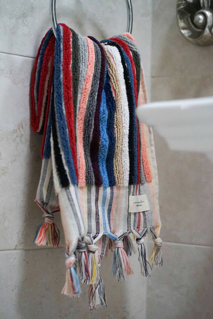 A multicoloured bath towel from Miss April Towels, made from 100% super soft absorbent Turkish cotton featuring rows of pom poms with tassels. Super absorbent and fast drying, it will compliment any bathroom!