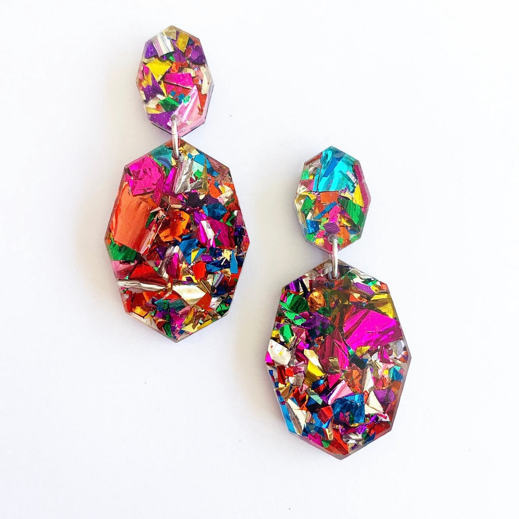 These earrings are the ultimate sparkle! Each to Own's Gemstar Double Drops in Fiesta Confetti will brighten up your day and your outfit! Made from gorgeous, multi coloured glitter acrylic they have surgical steel posts and are extremely lightweight. 6.2cm long.