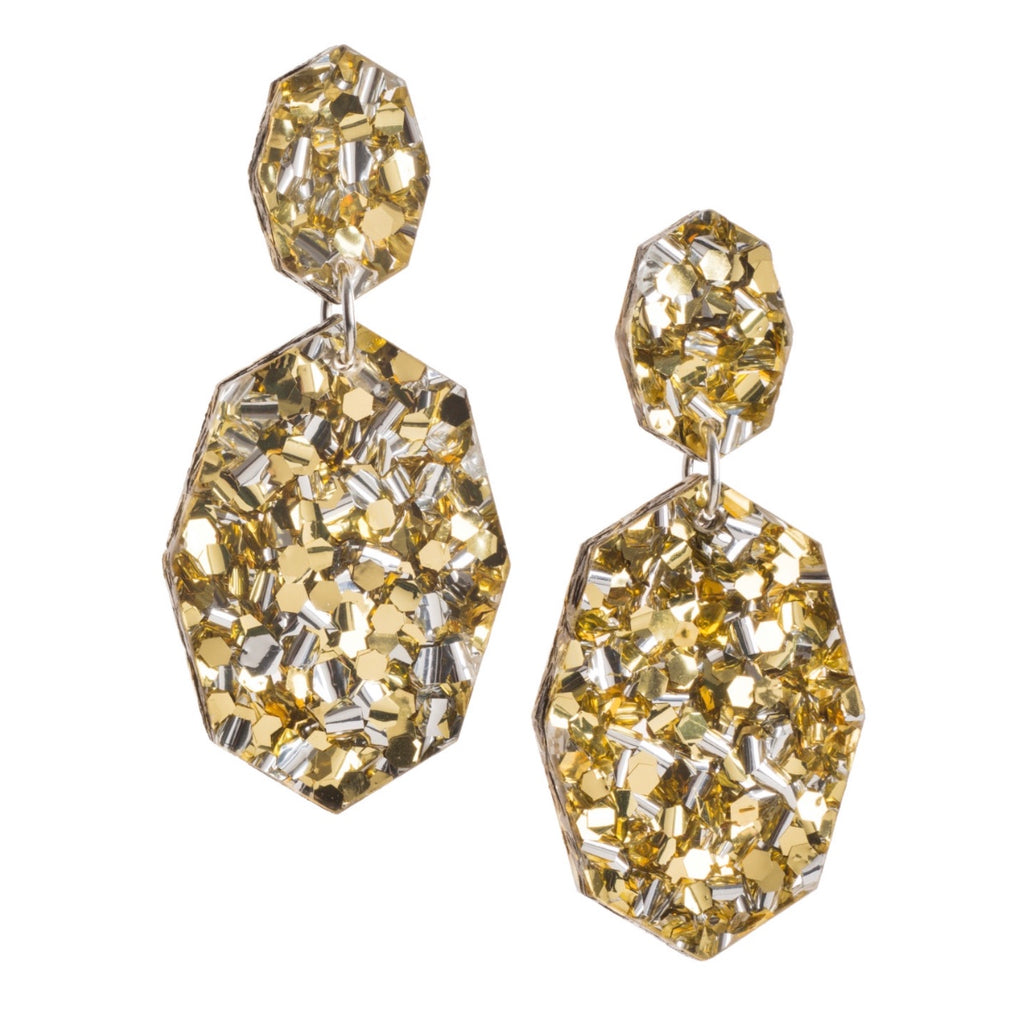 These earrings are the ultimate sparkle! Each to Own's Gemstar Double Drops in Gold Lush Glitter will brighten up your day and your outfit! Made from gorgeous, glitter acrylic they have surgical steel posts and are extremely lightweight. 6.2cm long.