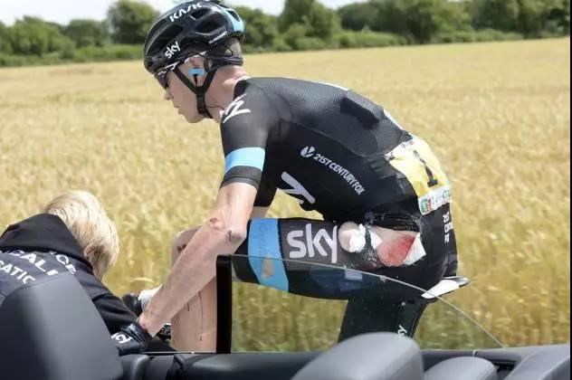 Chris Froom was treated after a crash in the fourth stage of the 2014 Tour de France