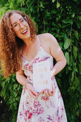 Emma Jane Catchpole holding This is Love Poetry Book