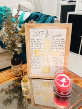 Load image into Gallery viewer, prophetic poem on coffee table, drawing of hand holding cross, candle in foreground