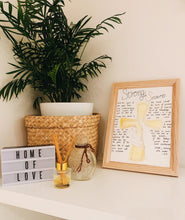 Load image into Gallery viewer, prophetic poem on shelf near plant, home of love sign, hand holding a cross