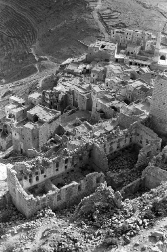 Bomb-damaged buildings at Suda