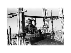 Fartus man weaving on a loom